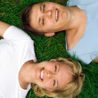 Man and woman lie on grass — Foto de Stock