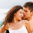 Attractive young couple on the beach — Stock Photo #1212399