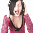 Emo girl in head phones - Stock Photo