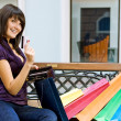 Stock Photo: Young womwith multi-coloured bags