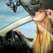 Make-up in car driving — Stock Photo