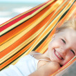 Child relaxing in a hammock — Stock Photo #1212536