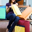 Young woman with multi-coloured bags — Stock Photo #1212578