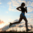 Silhouette woman run under blue sky with — Stock Photo