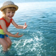 Little girl in blue water sea — Stock Photo