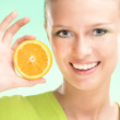 Young beauty woman with orange — Stock Photo