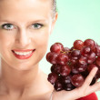 Young beauty woman with grapes — Stock Photo