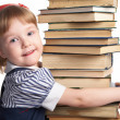 Little girl with book — Stock Photo #1213043