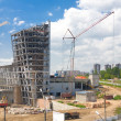 Building with crane - Stock Photo
