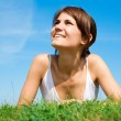Young woman lying on the green grass — Stock Photo