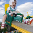 Pretty happy baby rock on swing - Stock Photo