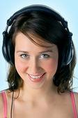 Pretty girl in head phones — Stock Photo