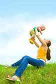 Mother with baby on the meadow — Stock Photo