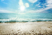 Beach sea and sky with clouds — Stock Photo