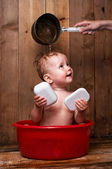 Baby is washing up — Stock Photo