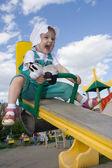 Pretty happy baby rock on swing — Stock Photo
