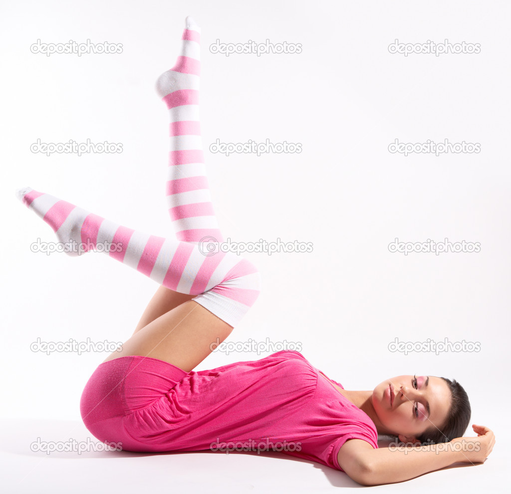 Beauty woman portrait in strip pink knee-length socks on gray background — Photo #1210472