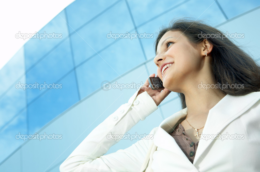 Beautiful  business woman on the phone at modern building — Stock Photo #1210870