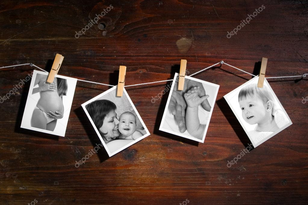 Pictures of a newborn and mother attach to rope with clothes spins on wooden background — ストック写真 #1211486
