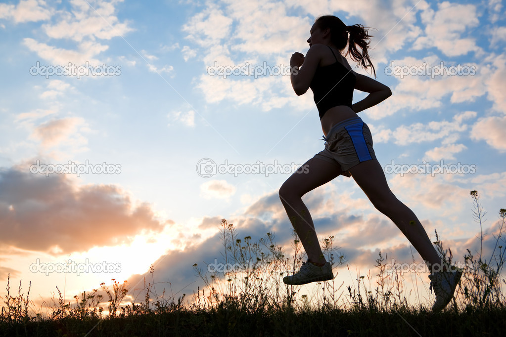 Silhouette woman run under blue sky with clouds and sun — Stock Photo #1211869