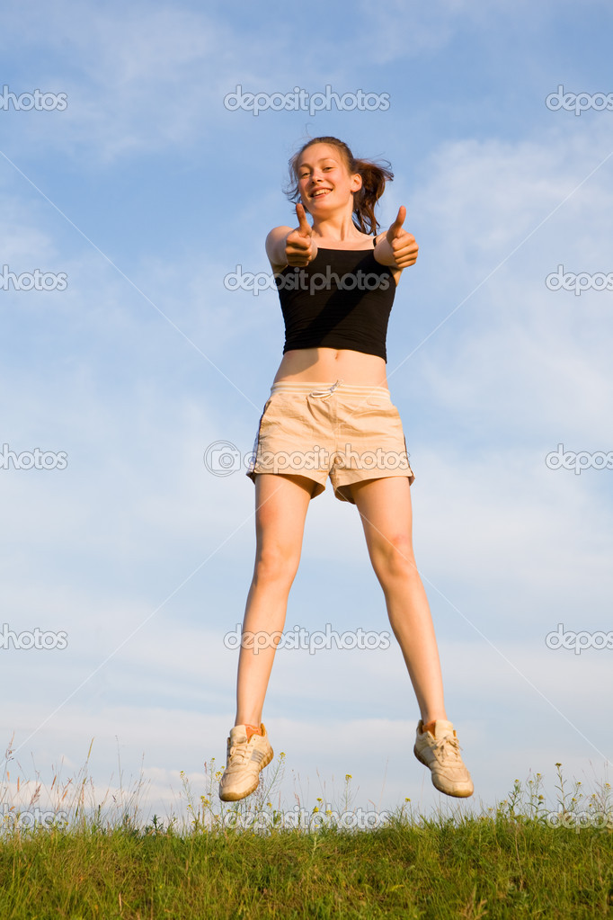Woman jump in field under blue sky — Stock Photo #1212172