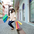 Stock Photo: Beauty womwith shopping bag