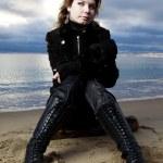 Beauty woman sit on beach — Stock Photo