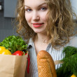 Beautiful woman in kitchen — Stock Photo