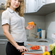 Beautiful woman in kitchen — Stock Photo #1671624