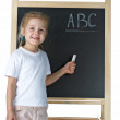 Little girl with blackboard — Stock Photo