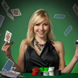 Poker player in casino - Stock Photo