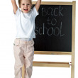 Stock Photo: Little girl and blackboard
