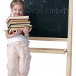 Little girl and blackboard — Stock Photo