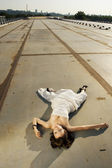 Bride lying on the road — Stock Photo