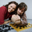 Arm restling and chess — Stock Photo
