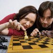 Couple playing chess game — Stock Photo