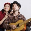 Couple with guitar - Stock Photo