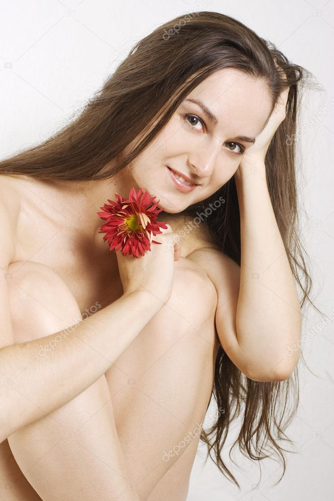 Beautiful young women holding flover in her hand. — Stock Photo #1320453