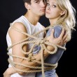 Frighten couple bound with ropes — Stock Photo