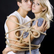 Frighten couple bound with ropes — Stock Photo #1443025