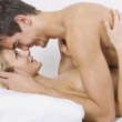 Happy couple on bed — Stock Photo