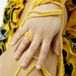 Royalty-Free Stock Photo: Hand holding string of yellow pearls.