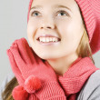 Stock Photo: Girl in winter clothing looking up