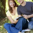 Young happy couple reading a book — Stock Photo