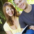 Couple reading outdoors — Stock Photo #1544064
