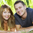 Portrait of cheerful couple in the park - Stock Photo