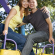 Smiling couple on the carousel — Stock Photo
