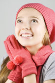 Girl in winter clothing looking up — Stock Photo