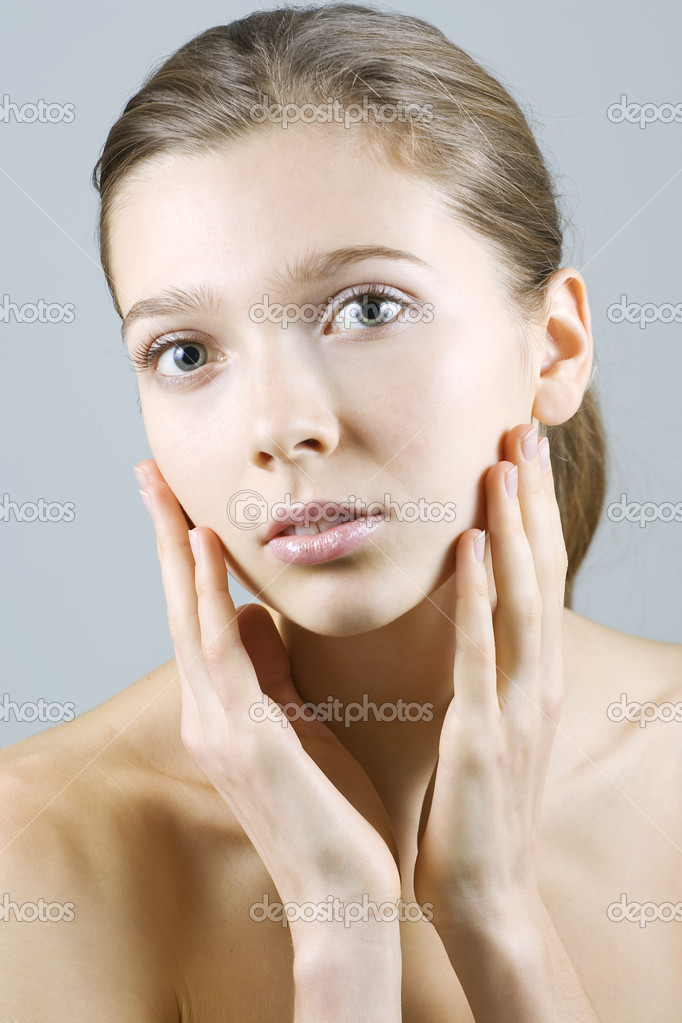Beautiful young woman delightfully touching her face.  — Stock Photo #1542761