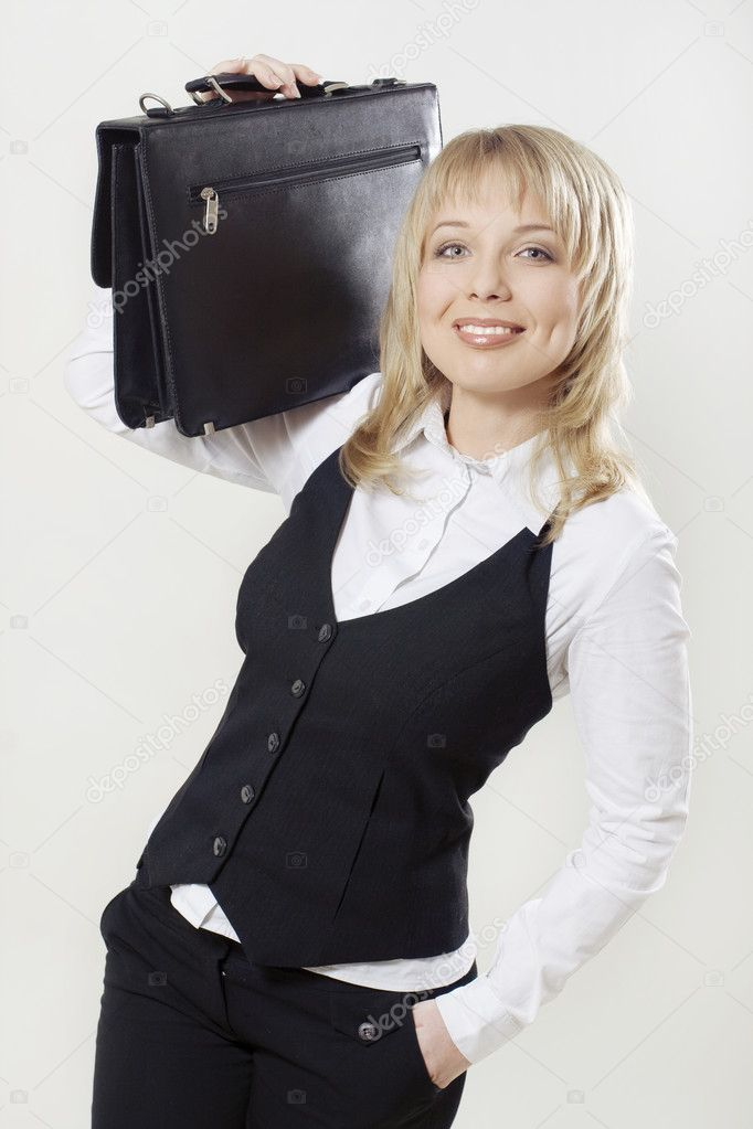 Beautiful businesswoman with leather suitcase  — Stock Photo #1543402